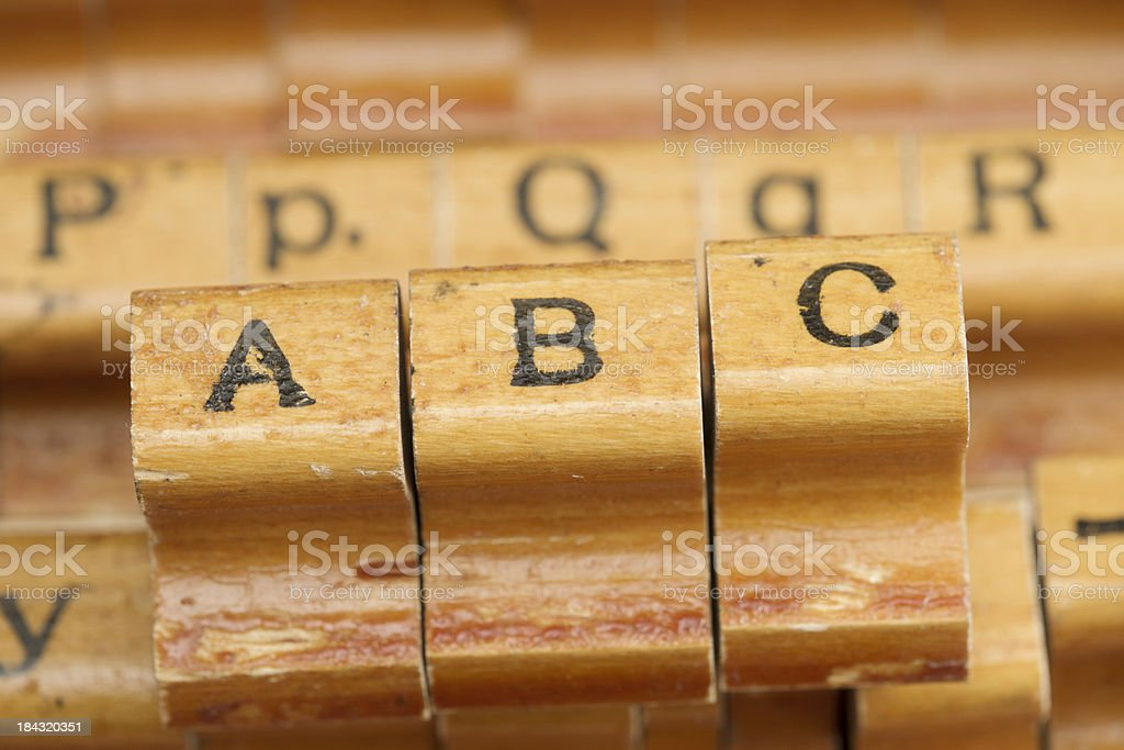Wooden Alphabet Stamps Spelling ABC royalty-free stock photo