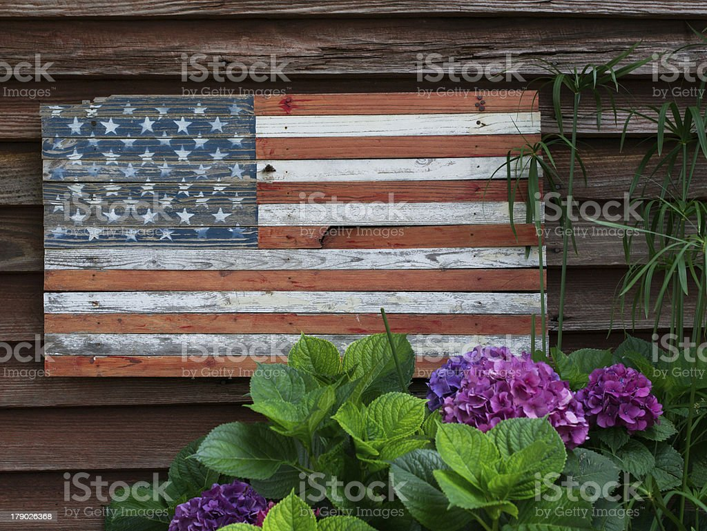 Wooden American Flag and Flowers stock photo