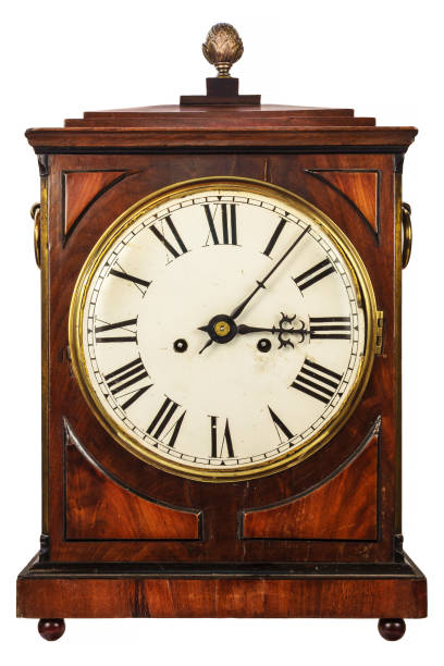 Wooden ancient clock isolated on white stock photo