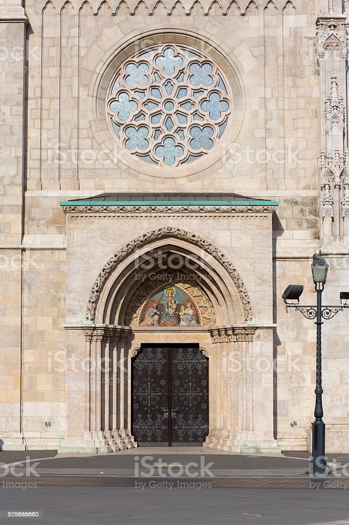 Wooden ancient door of Matthias Church in Budapest stock photo