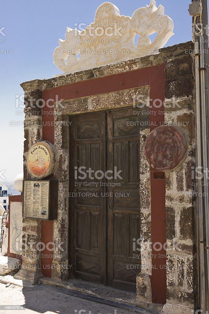 wooden and grungy restaurant door stock photo