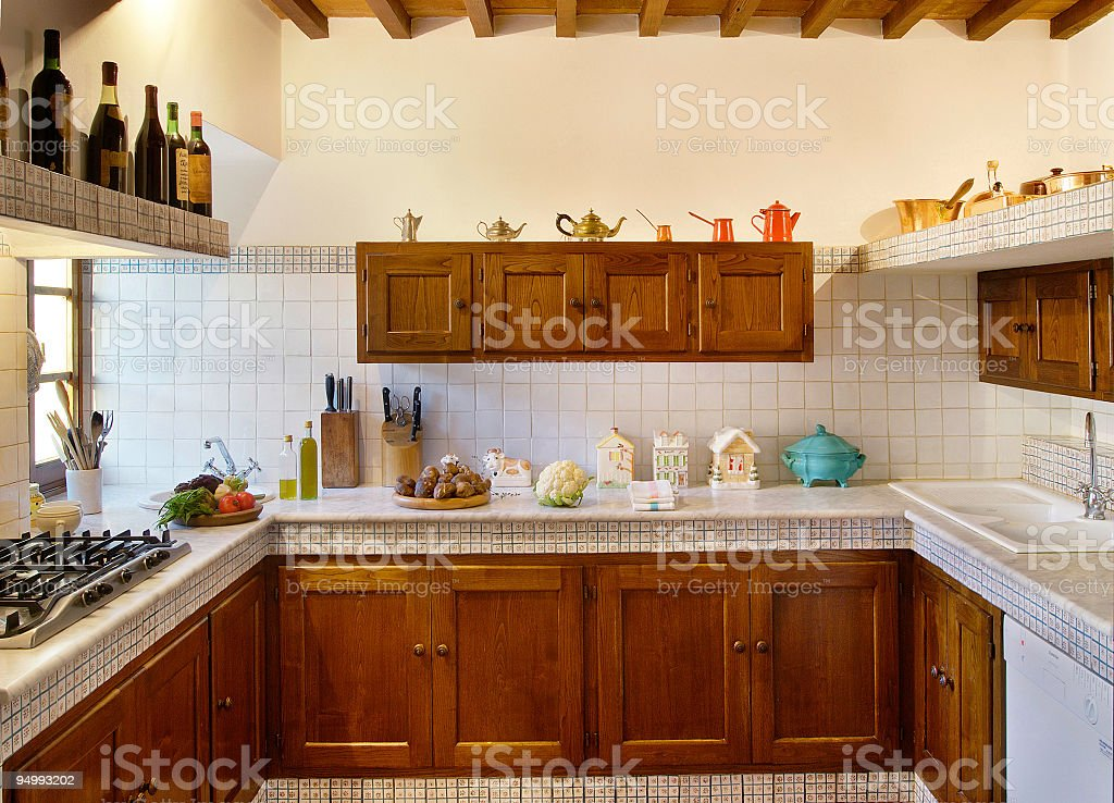 Wooden and marble kitchen in a beautiful italian rustic house stock photo