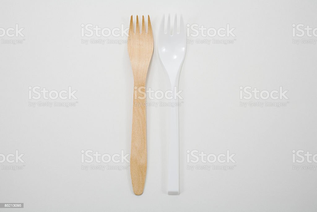 A wooden and plastc disposable fork royalty-free stock photo