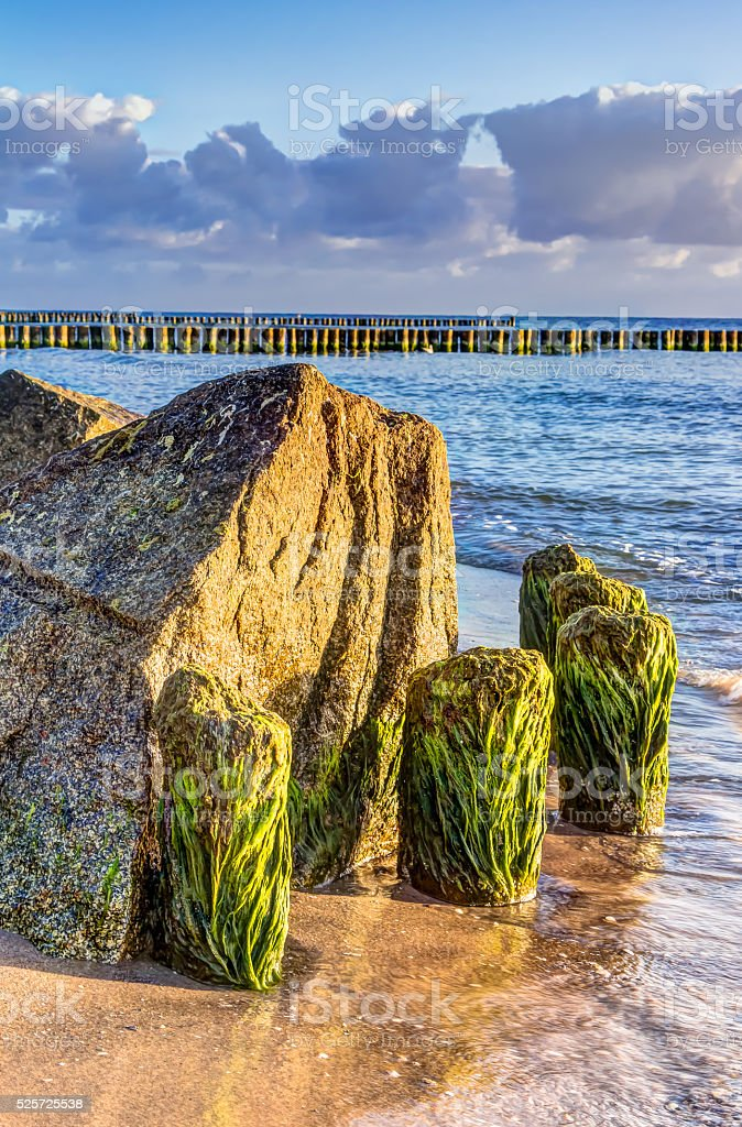 Wooden and rocky groynes stock photo