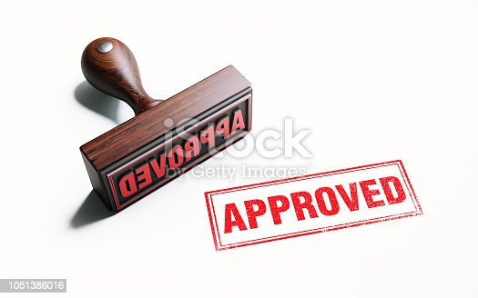 Wooden approved stamp on white background. Horizontal composition with copy space.