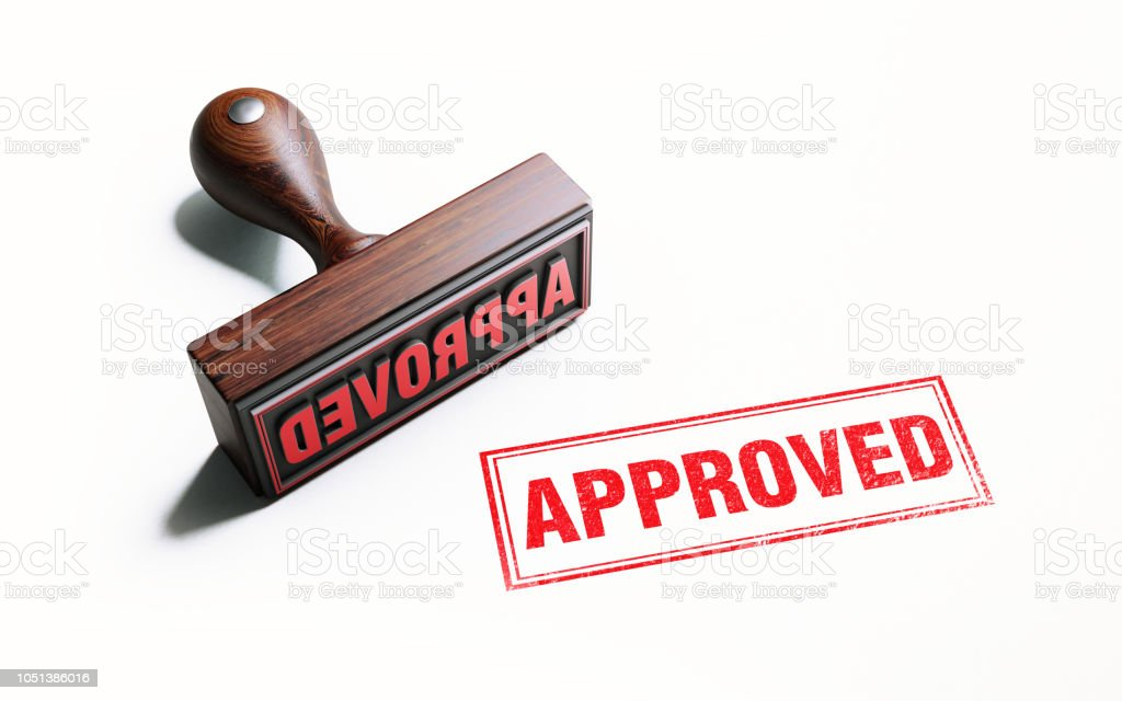 Wooden Approved Stamp On White Background stock photo