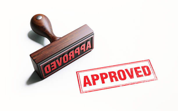 wooden approved stamp on white background - permit stock photos and pictures