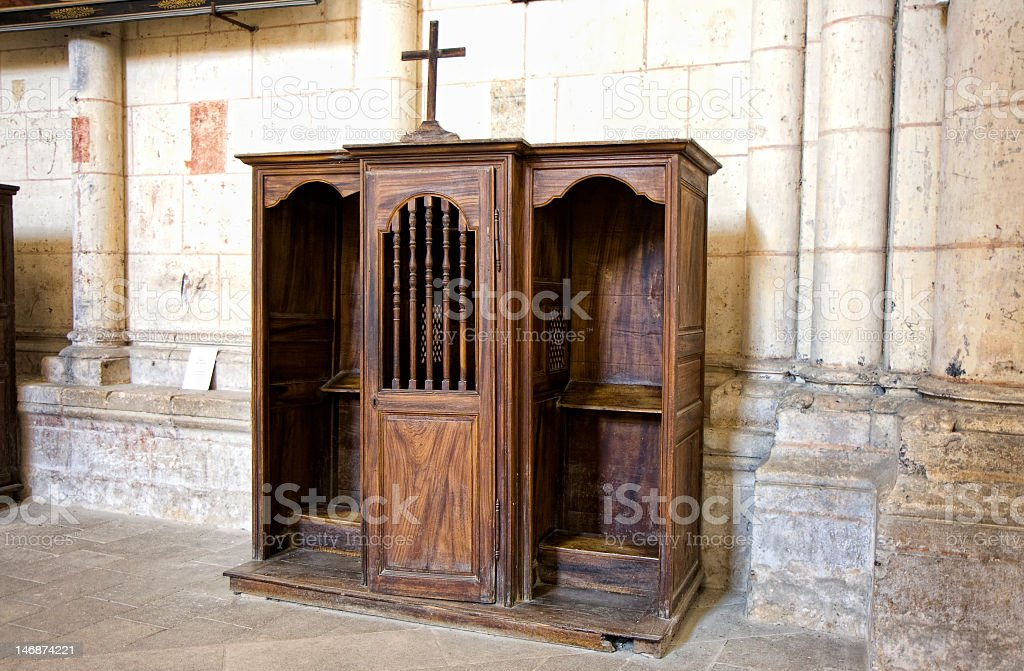 Wooden arched confessional at St. Pierre Cathedral in France stock photo