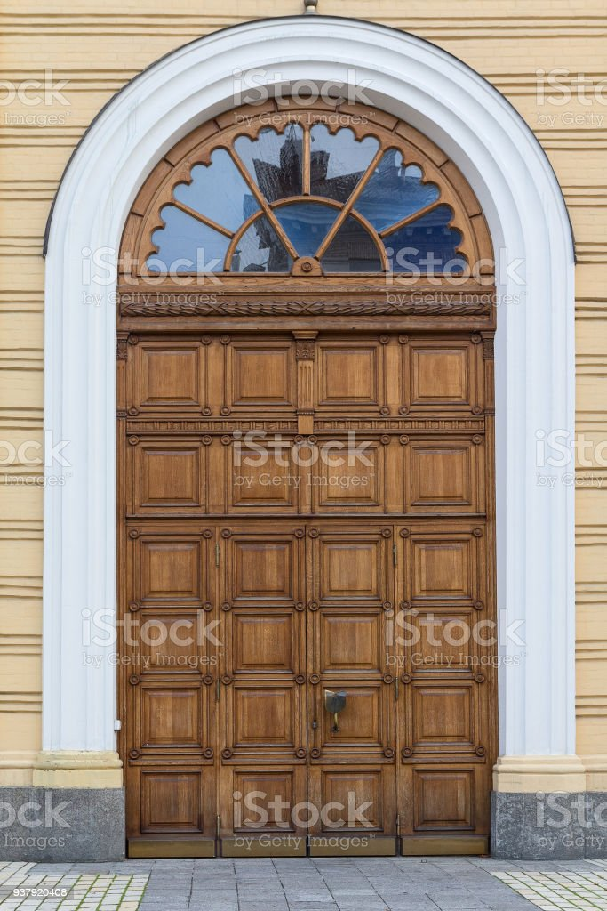 Wooden arched door in the classical style. The Architecture stock photo