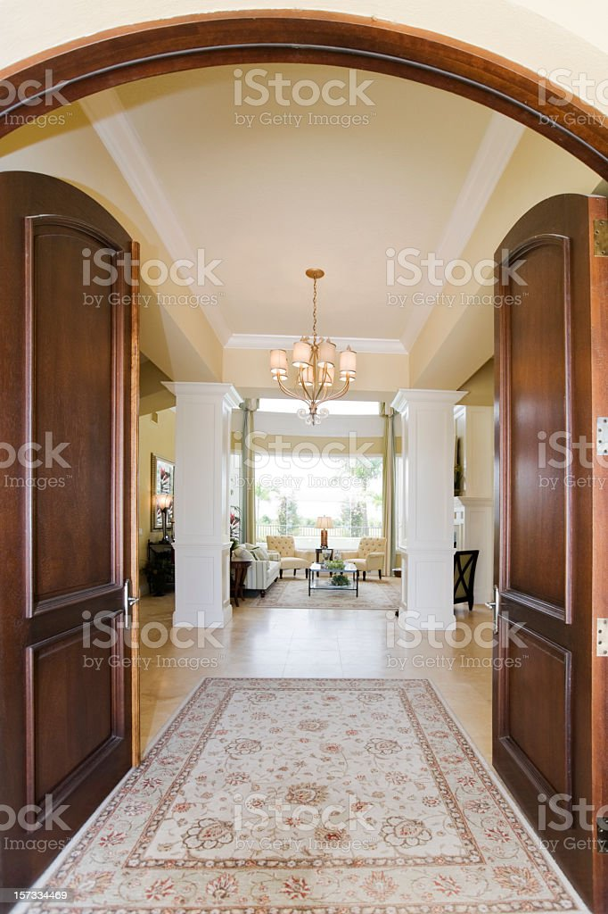 Wooden arched entryway into a luxurious home  stock photo