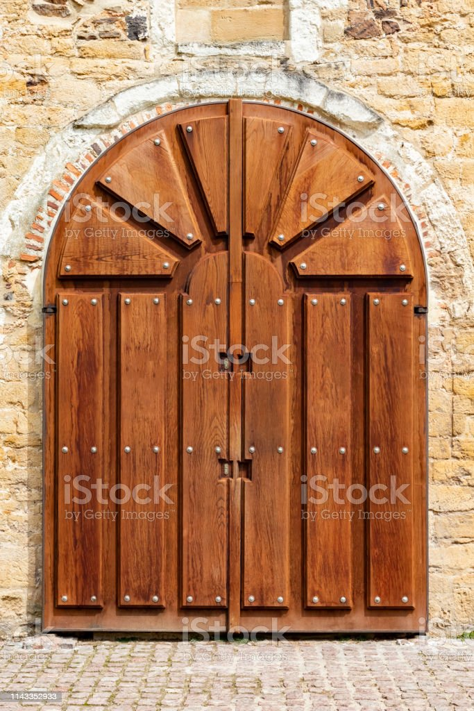 Wooden Archshaped Gate To An Ancient Church Stock Photo Download