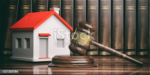 istock Wooden auction or judge gavel, a small house and books. 3d illustration 1021303764
