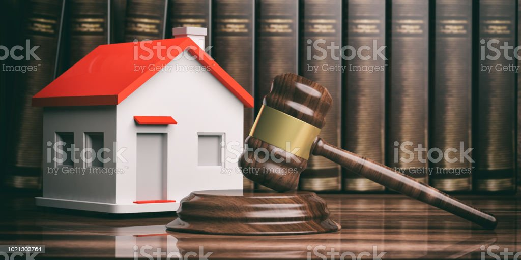 Wooden auction or judge gavel, a small house and books. 3d illustration stock photo