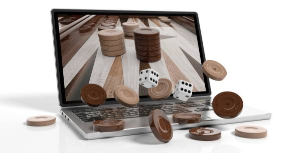 Wooden backgammon out of a laptop. 3d illustration Wooden online backgammon concept on white background. 3d illustration backgammon stock pictures, royalty-free photos & images