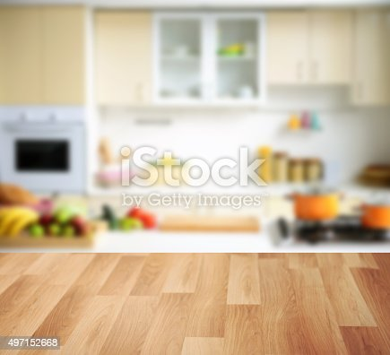 istock wooden background and Defocused kitchen background 497152668
