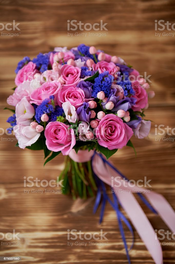Wooden background, Wedding bouquet in pink and purple tones. Beautiful and delicate royalty-free stock photo