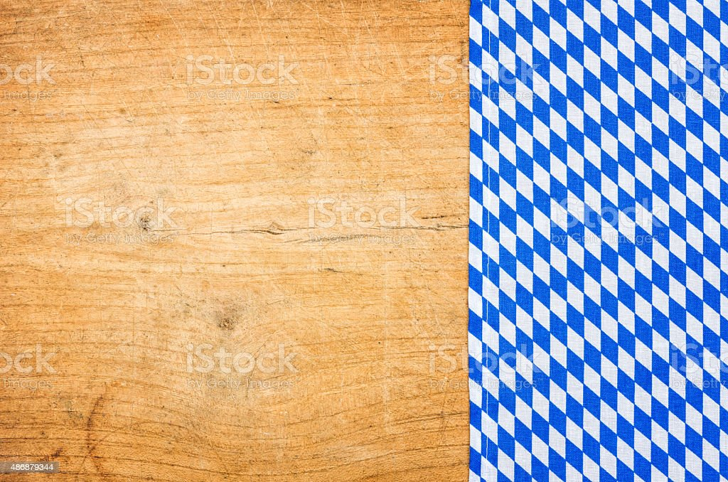 Wooden background with a bavarian tablecloth stock photo