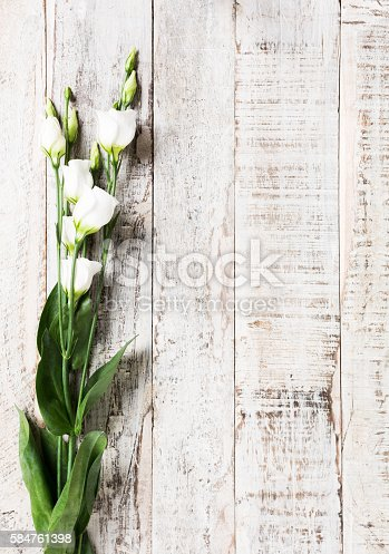 istock wooden background with bouquet of white flowers 584761398