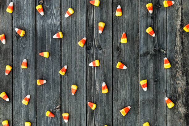 Wooden Background With Candy Corn For Halloween stock photo