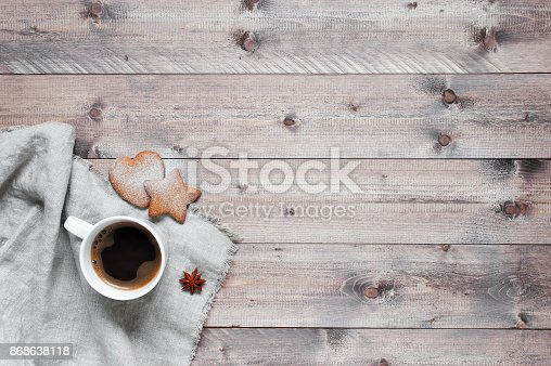 istock Wooden background with cup of coffee 868638118
