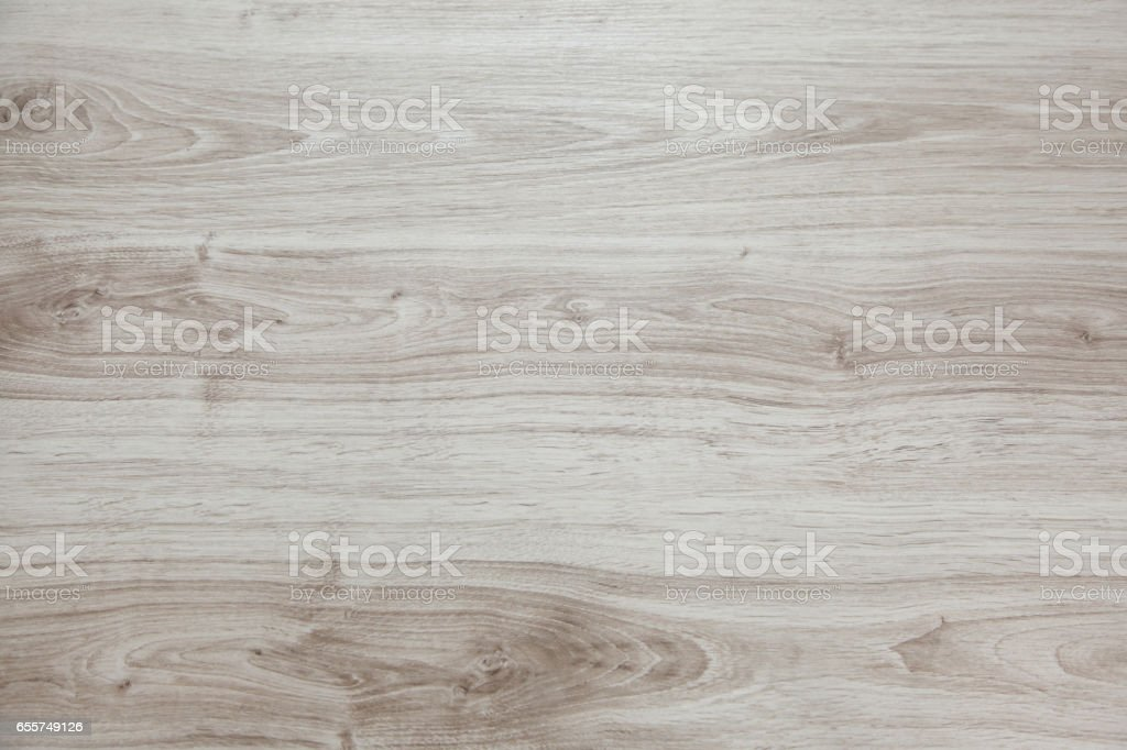 Wooden background with light and gray patches. Laminate. stock photo