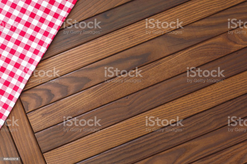 Wooden background with red and white checkered tablecloth stock photo