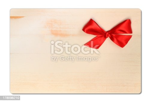 670414478 istock photo wooden background with red bow 178596210