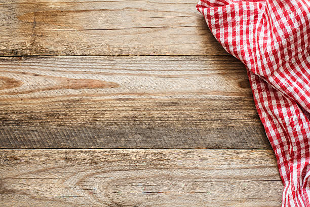 Wooden background with textile and copy space for text Wooden background with textile / Cooking food / pizza wooden table background with red and white textile. Copy space for text red cloth stock pictures, royalty-free photos & images