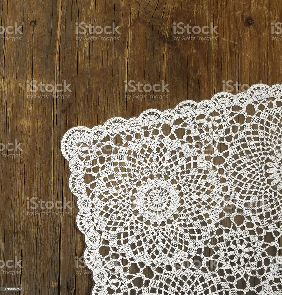 wooden background with white lace napkin stock photo