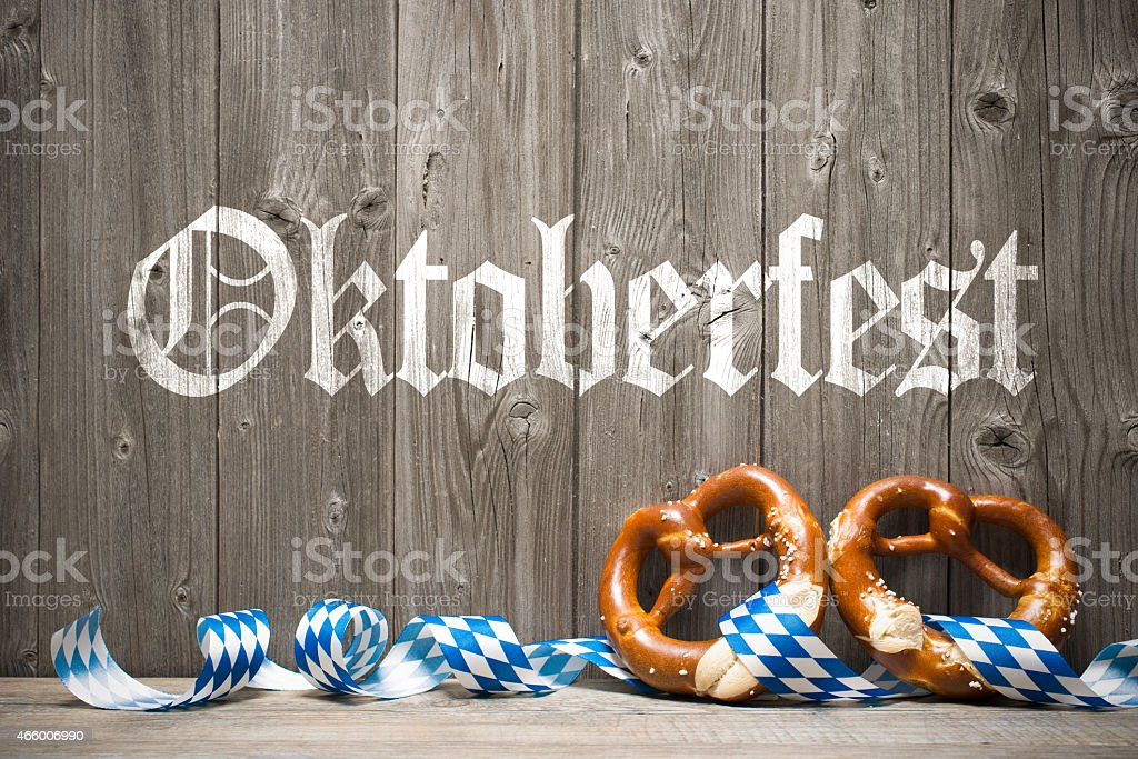Wooden background with white painted writing for Oktoberfest stock photo