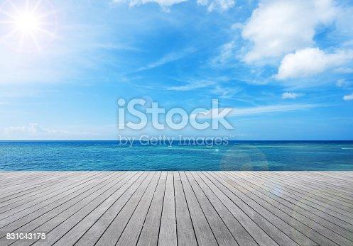 Wooden balcony beside tropical sea