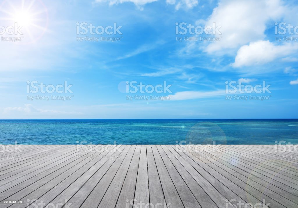 Wooden balcony beside tropical sea stock photo