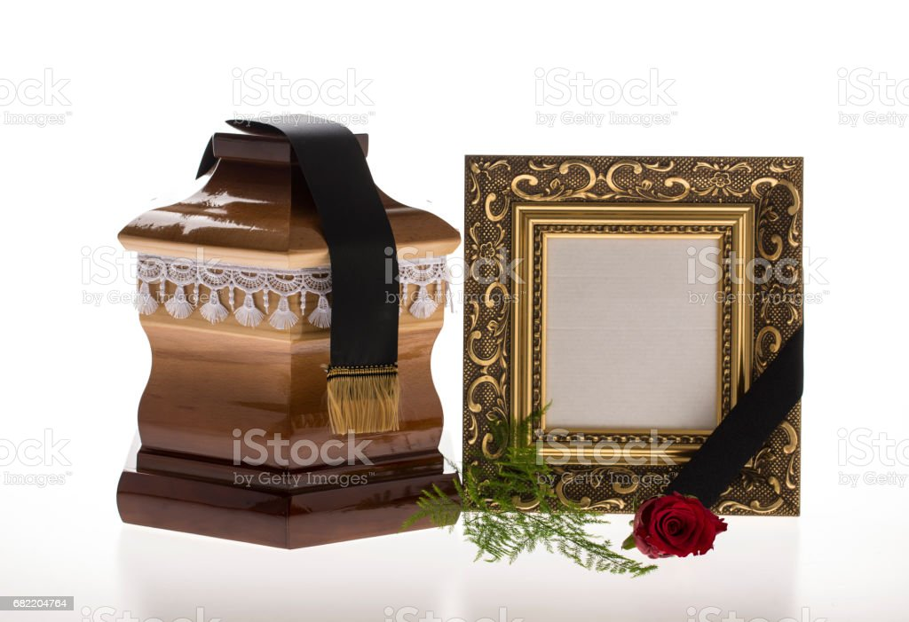 Wooden ballot box with golden mourning frame and flower stock photo