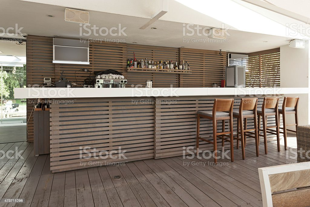 Wooden bar and chairs stock photo