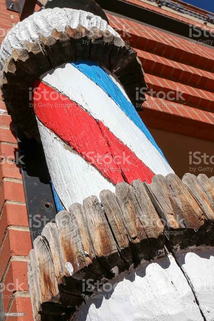 Wooden barber's pole with perspective from below stock photo