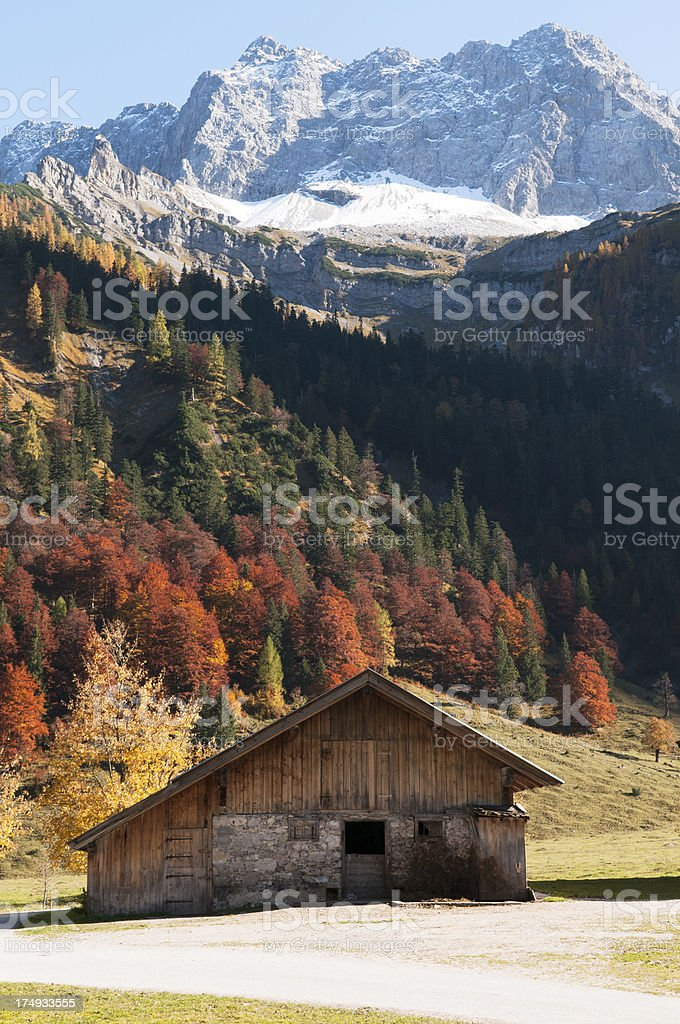 Wooden Barn in Front of Mountain Range royalty-free stock photo