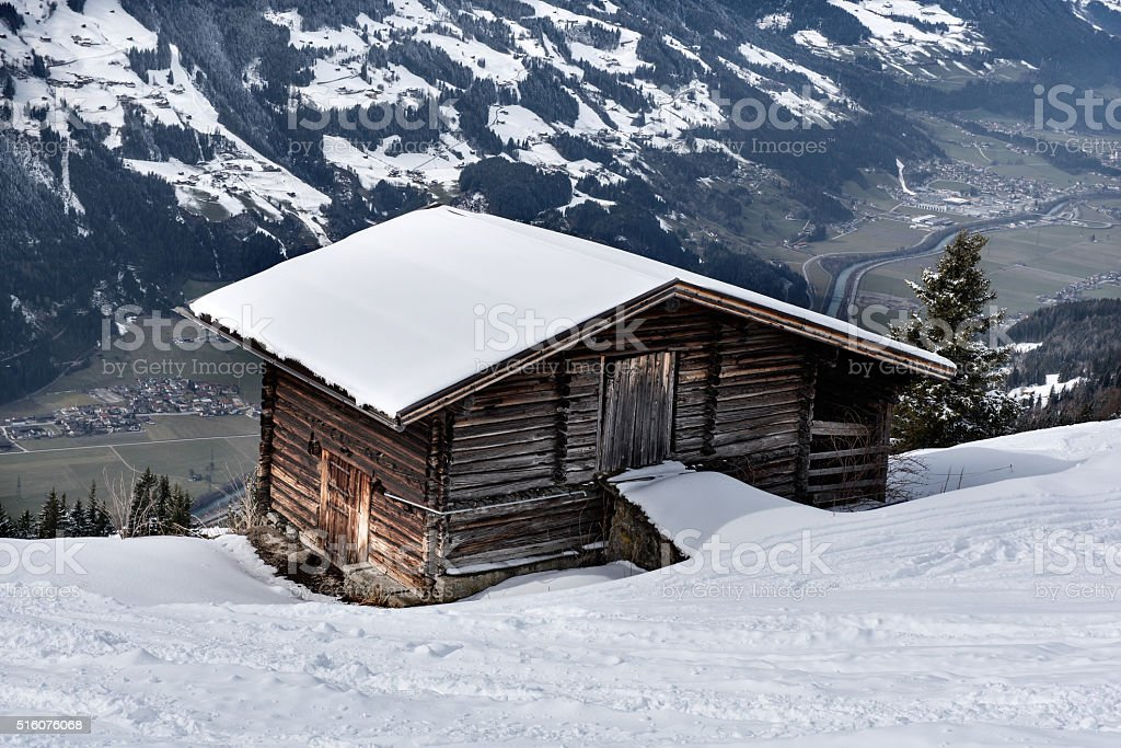 Wooden barn looking out over the valley of the Zillertal stock photo
