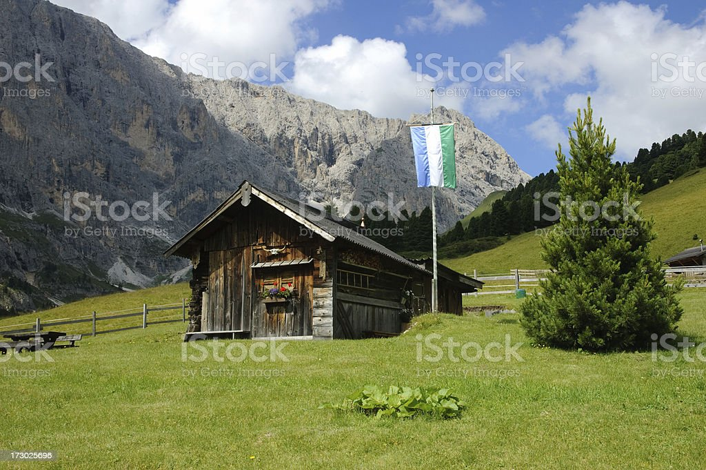 Wooden barn wiht flag stock photo