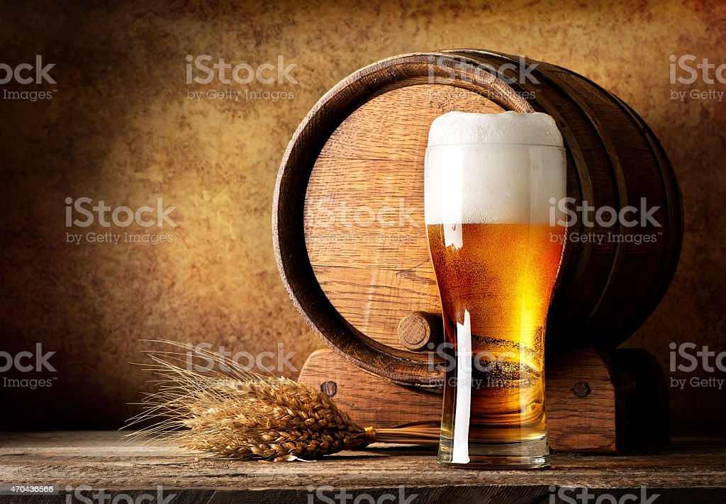 Wooden barrel and beer stock photo