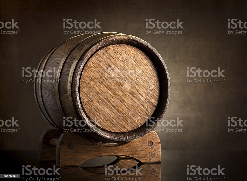 Wooden barrel in a dark brown setting stock photo