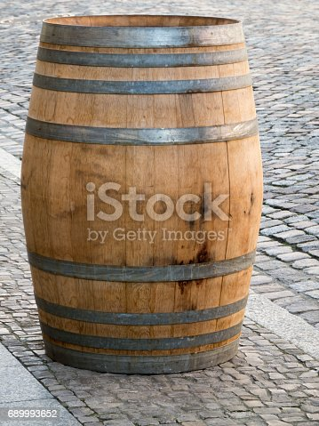 Single wooden barrel on the sidewalk in the Luther-City Wittenberg.