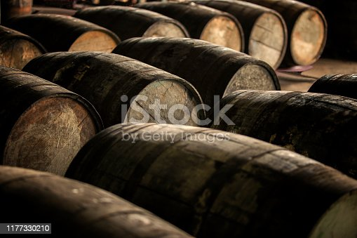 Old wooden (oak) barrels. Rum or wine aging process.