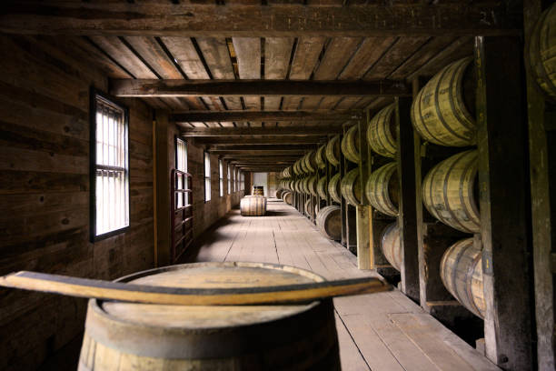 Wooden barrels room Distillery whiskey wooden barrel container room factory in Kentucky, USA AM stock pictures, royalty-free photos & images