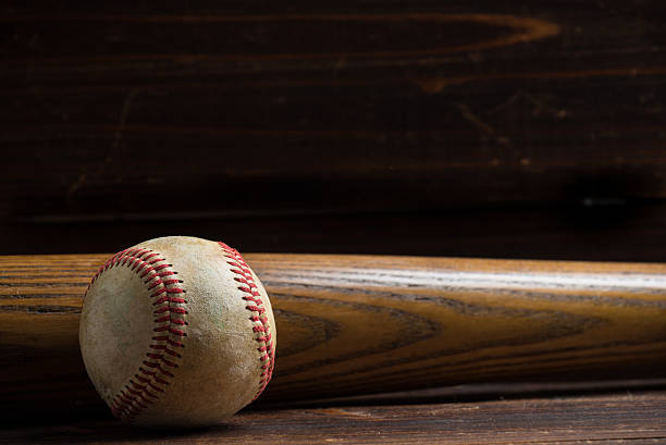 wooden baseball bat and ball on a wood background - baseball bat stock photos and pictures