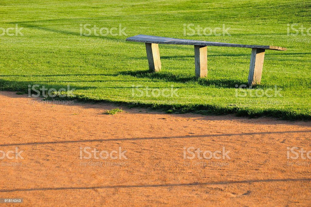 Wooden Baseball Player's Bench in a Small Town royalty-free stock photo