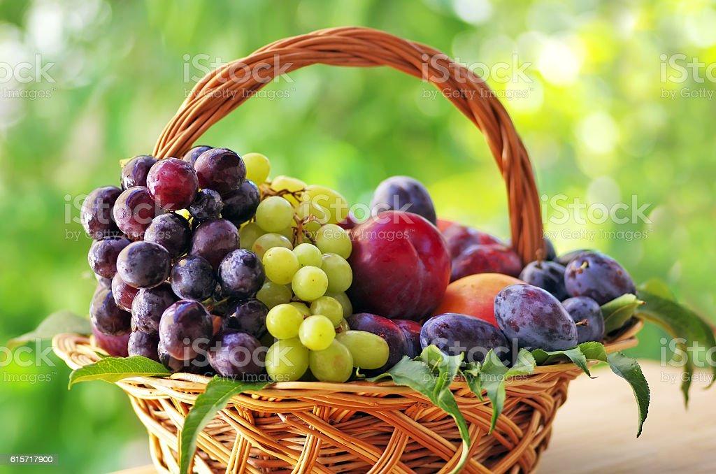 wooden basket full of fruits stock photo