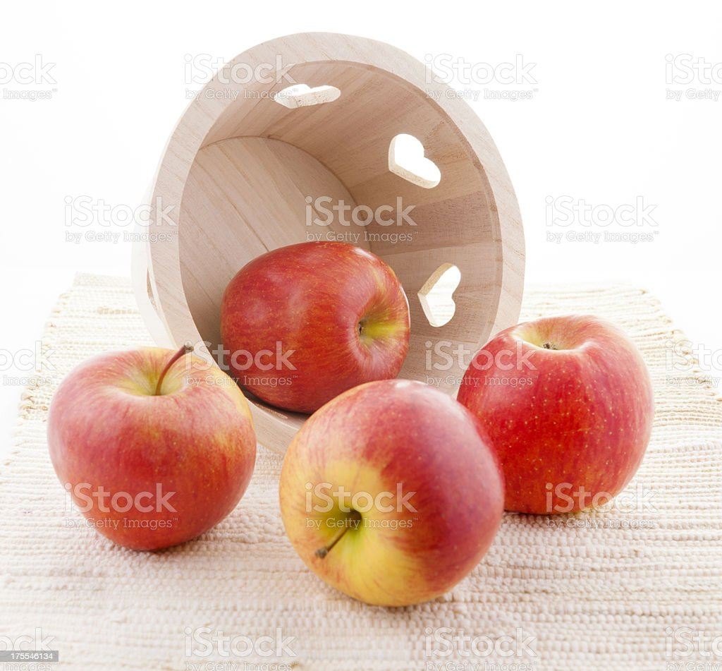 Wooden basket with Red Kiku Apples royalty-free stock photo