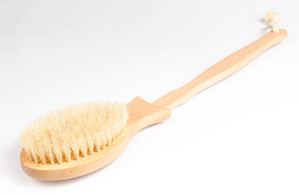 Wooden Bath Brush Wooden Bath Brush on White background scrubbing brush stock pictures, royalty-free photos & images