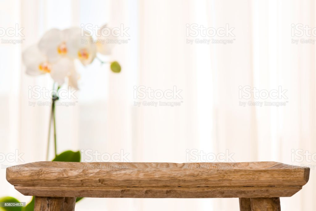 Wooden Bathroom Table On Abstract Blurred Background With Orchid Flower Royalty Free Stock Photo
