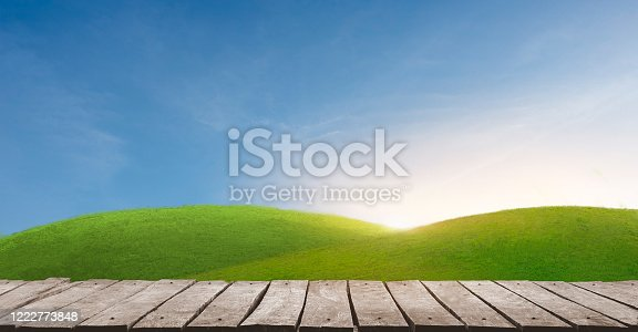 989111446 istock photo wooden batten bridge juts out into the expanse of the beatiful sunset. 1222773848